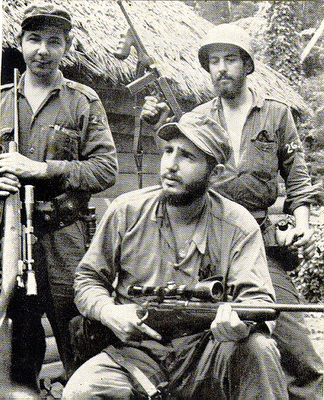 Raul, left, and Fidel training rebels in the mountains